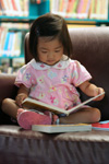 a child reading at a library